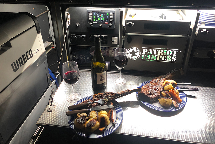 The back of a Patriot Camper where dinner is served